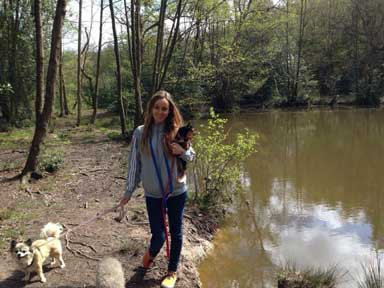 Joss walking the dogs beside a small pond